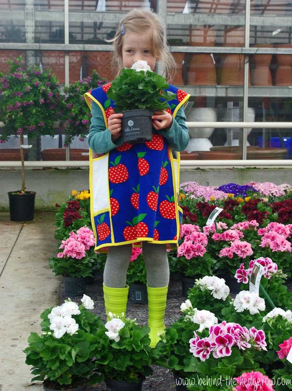 gardening-apron-holding-plant