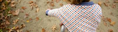 Julia sweater autumn leaves on a bike